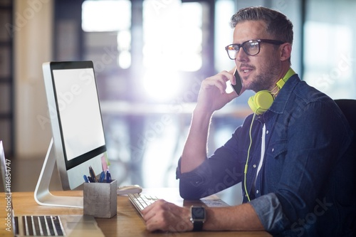 Man talking on phone in office плакат
