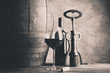 wine glass bottle barrel and corkscrew - black and white photo