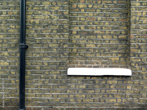 Poster London Bricked Window / Background wall with windows bricked up and gutter