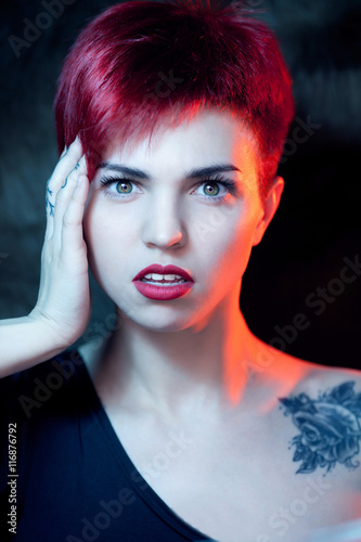 Closeup portrait of surprised beautiful red haired Poster