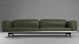 Grünes Sofa aus Leder vor Wand