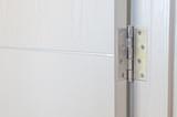 Fototapety door hinges Aluminum on  white door