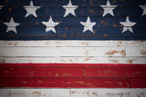 United States flag painted on wooden planks forming a background - 116884113