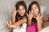 Fototapety Little girls with painted nails.