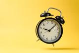 vintage alarm clock falling on the floor
