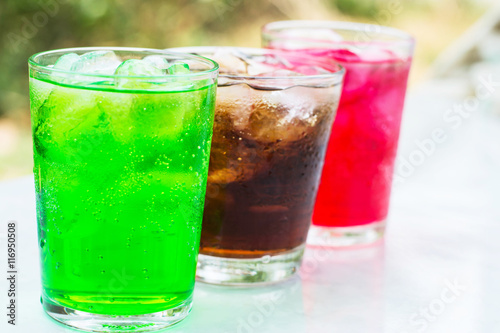 Poster soft drink in a glass with ice cubes