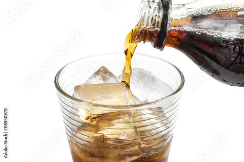 Poster soft drink being poured into glass with ice cubes