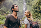 Fototapety Young couple with backpack hiking in nature
