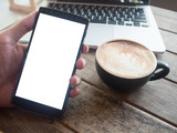 Close up of a man using smart phone with blank mobile and cup of coffee..Smart phone with blank screen and can be add your texts or others on smart phone.