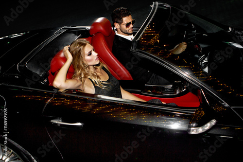 Plakát Couple in luxury car.