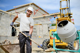 portrait of handsome construction worker on a building industry construction site - 116997571