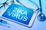 Zika virus word on tablet screen with medical equipment on background