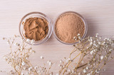 Cosmetic clay and clay powder in a jar on a wooden background. Healthy skin care. - 117011953