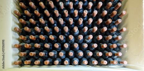 Old wine bottles in cellar. © Calin Stan