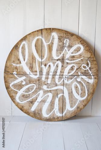 Poster Love words.Love me tender. Letters written on wooden background