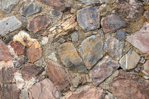 real medieval stone wall surface can use as background pattern or texture at old town Songkhla Thailand