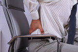 Business man with back pain sitting in an office chair. Pain relief concept - 117106720