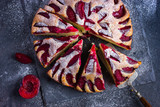 rustic plum  cake on dark background