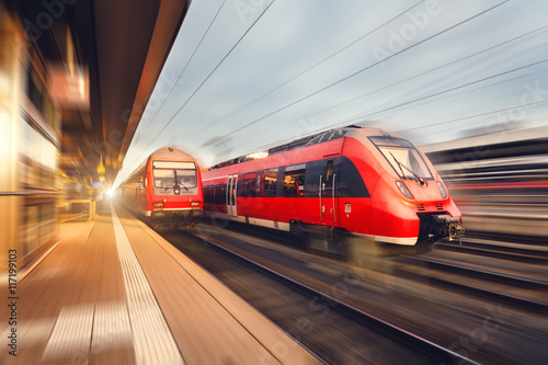 Plakát Modern high speed red passenger trains at sunset