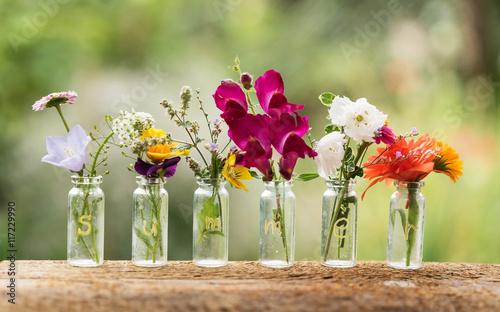 Zdjęcia na płótnie, fototapety, obrazy : nice flowers in the bottles