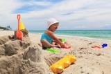 little girl play with sand on beach