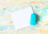 white pad with blue mouse on colorful wooden background