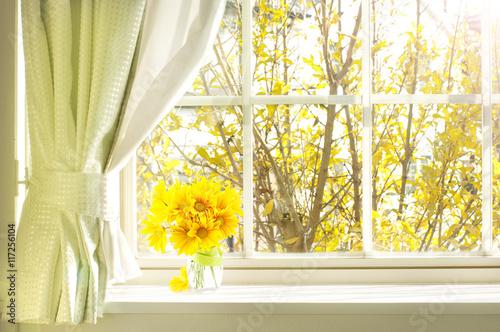 bouquet of flower on a windowsill in a fall - 117256104
