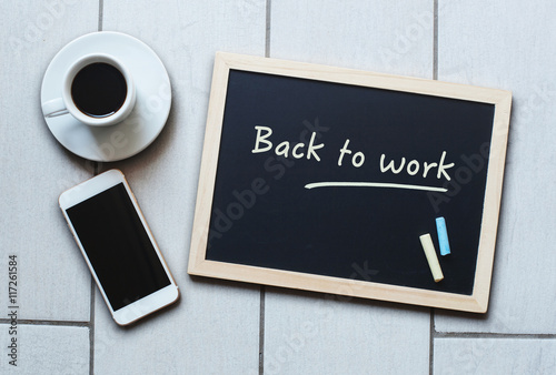 Poster Chalkboard or Blackboard concept saying Back to Work