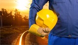 Hand of worker with hard-hat.