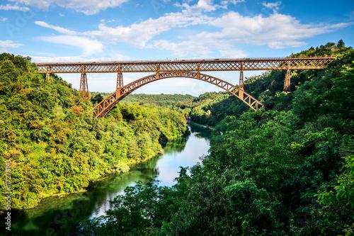 Obraz na Plexi iron bridge over the river Adda Lombardia Italy