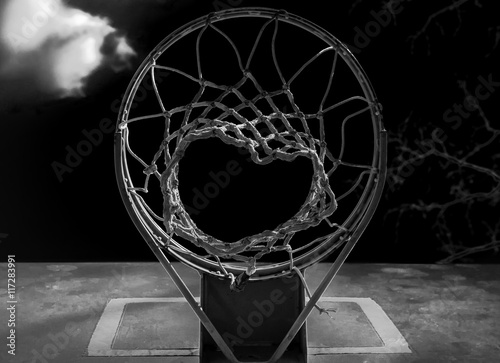 Isolated Basketball hoop. Isolated abstract basketball hoop. Outdoor basketball court. Playground court. Black and white. Monochrome. Chromatic.  - 117283991