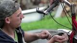 mountain bike repairs/young man mountain bike repairs outdoors