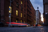 Quiet street in SOHO, New York, USA with light trails of cars passing - 117327710