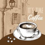 Plakat z obrazem filiżanki kawy na beżowym tle europejskiego krajobrazu.