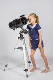 Young funny astronomer looks through the eyepiece of the telescope
