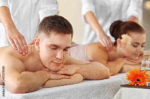 Handsome man and beautiful girl relaxing in spa salon © Africa Studio