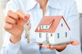Real estate agent hand over property or new home keys to a customer - 117381976
