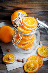 Candied oranges in jar, cinnamon and almond
