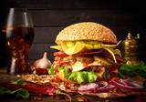 Tasty hоmemade delicious burger with guacamole and nachos on a