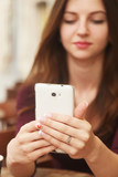concept portrait of addict young woman taking selfie photo with