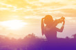 Silhouette women play violin sunset background