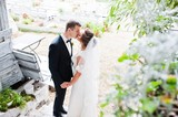 Wedding couple kissing and holding hands