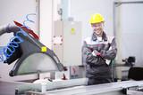 Worker at CNC machine shop