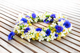 Floral wreath on wooden table.