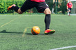 Futsal / Football / Soccer. A player hits the ball on the artificial turf