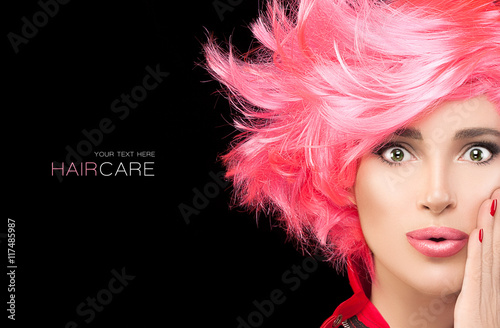 Fotobehang Kapsalon Fashion model girl with stylish dyed pink hair