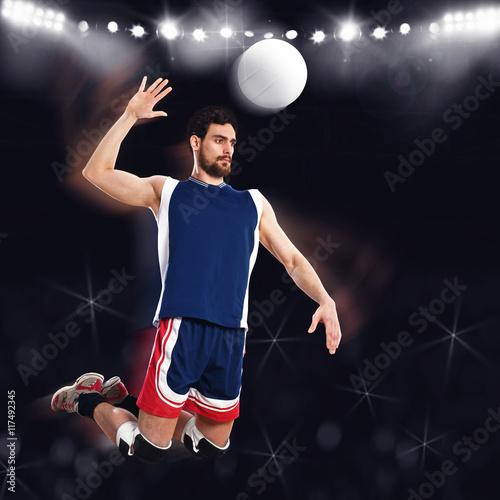 Fototapeta Volleyball player beats ball