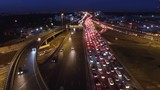 Complex road junction from above. Unique night aerial drone flight. Center of Europe modern Moscow. Evening road traffic, cars moving. High altitude footage. Best 4K video.