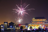 Fireworks up ancient buildings at night, in China