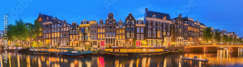 Fototapeta Amstel river, canals and night view of beautiful Amsterdam city. Netherlands